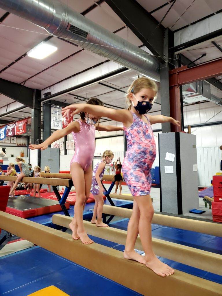 Gymnasts on the beam at Gymfinity